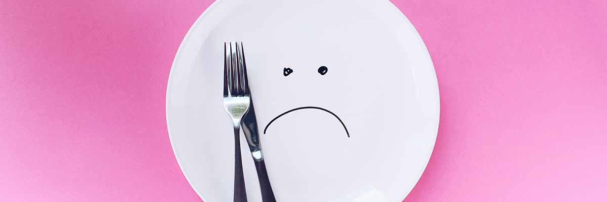 empty plate with frowny face