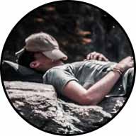 man asleep in creek