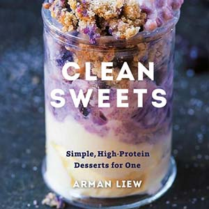 book cover with fancy glass full of yogurt some kind of blended creamy purple stuff and granola