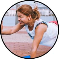 woman smiling while doing a push-up