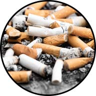 pile of smoked cigarettes and ash